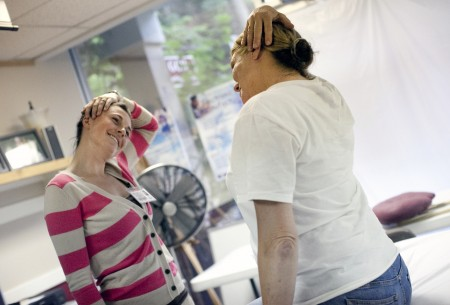 DPT student shows a client exercises to relieve her headaches