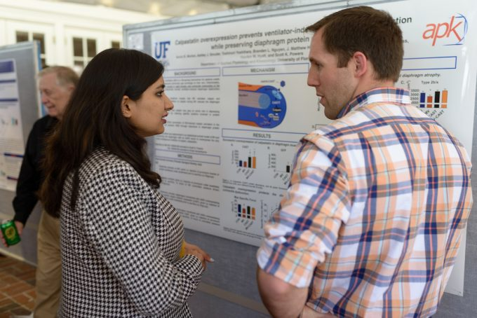 Former NMPT trainee Aaron Morton (left) discussing with Kanika Bansal.