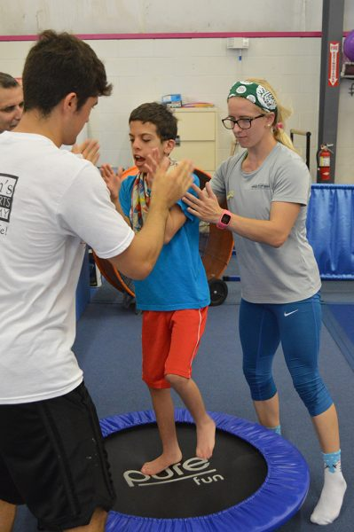 Erin Waterman working with a child with developmental disabilities at Balance 180.