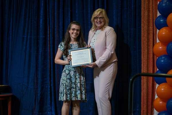 DPT grad Grace Kupiszewski receiving the Martha C. Wroe award from Dr. Judi Schack-Dugre