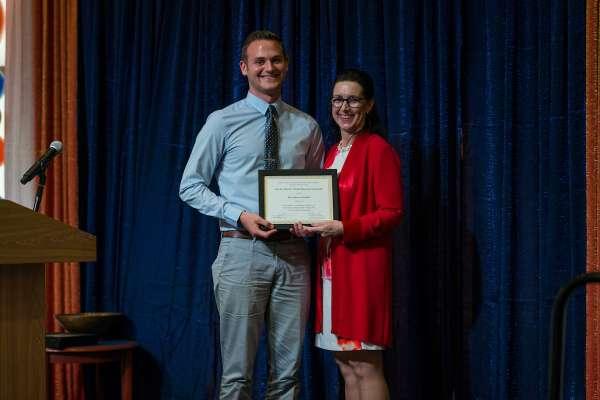 Brett Zebelian receiving the Dr. Mark Trimble Memorial Scholarship from Dr. Kim Dunleavy