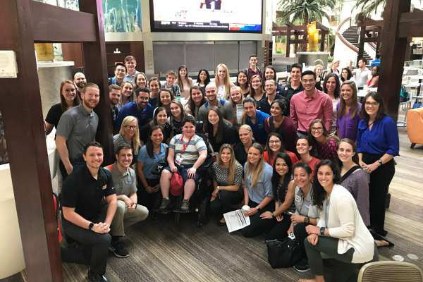 UF DPT students in a group photo with a boy who has Duchenne Muscular Dystrophy at the annual PPMD conference