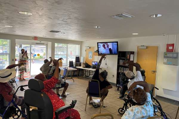 Group class at the Gainesville Housing Authority led virtually by the students in the Community Health outreach group.