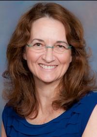 Headshot of Dr. Claudi Senesac