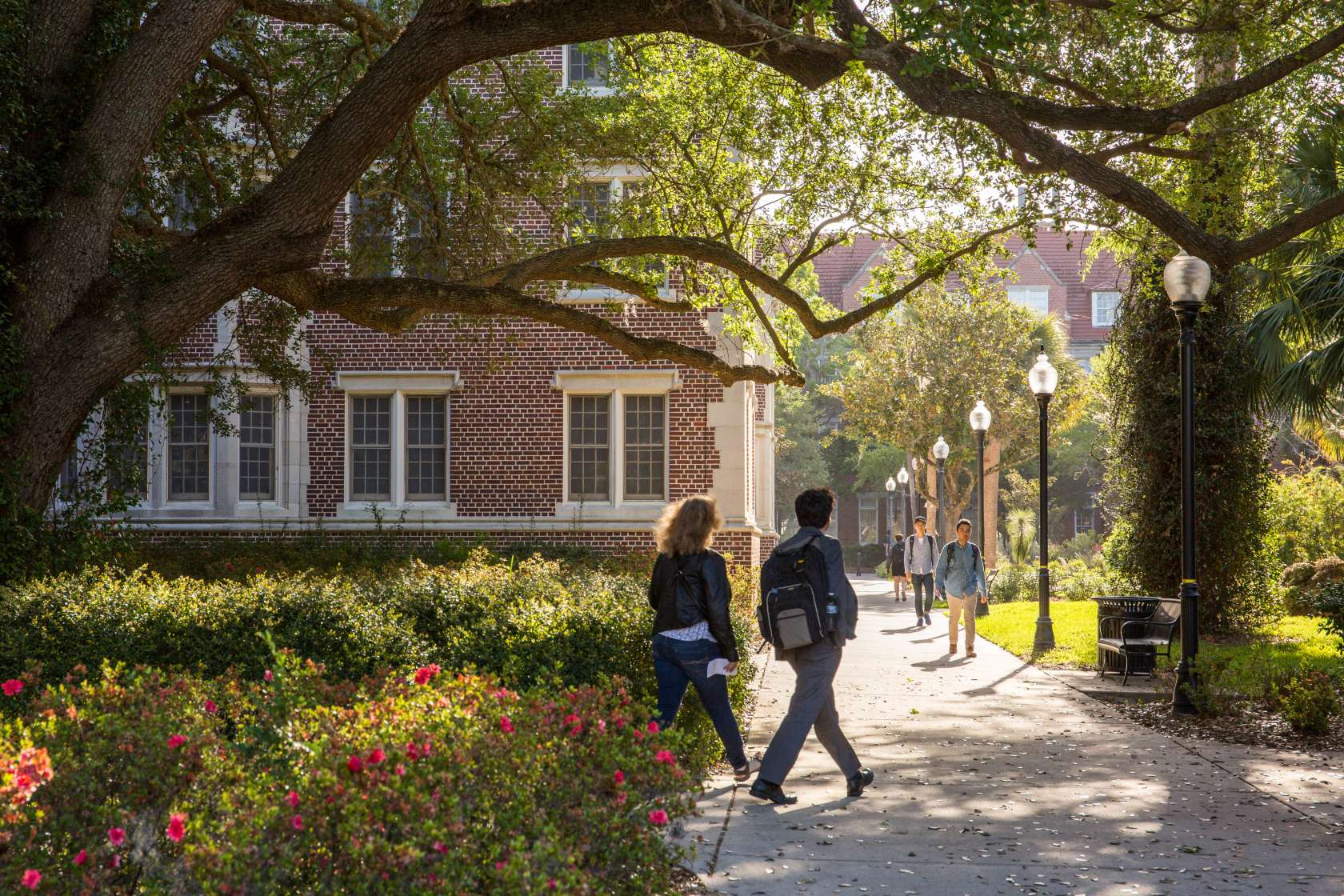 two students walking on UF campus