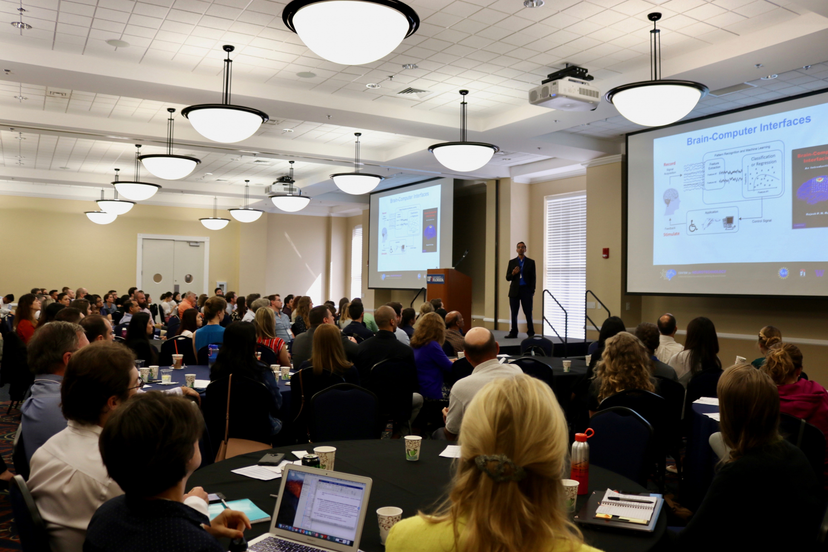 Rajesh Rao, PhD, CJ and Elizabeth Hwang Professor at the University of Washington (UW), gives a keynote presentation to over 200 guests at the 2019 Neuromuscular Plasticity Symposium.