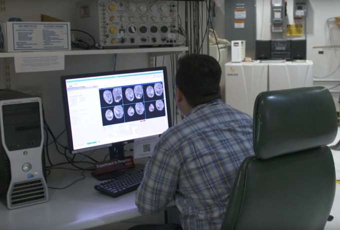 researcher looking at images of muscles