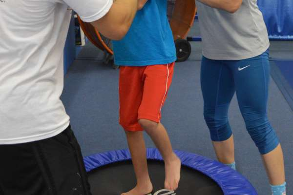 DPT Students working with an athlete at Balance 180 for Children on the Go