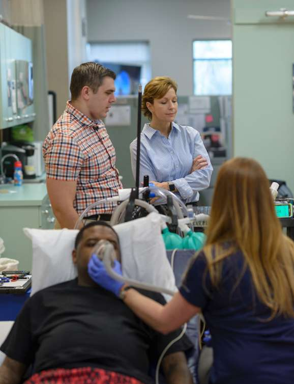 Clinicians demonstrate intermittent hypoxia therapy.