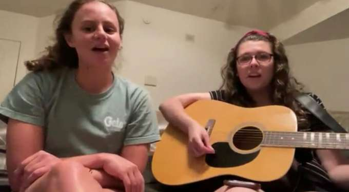 Olivia Nash and Micayla Kinder singing and playing Down by the Bay