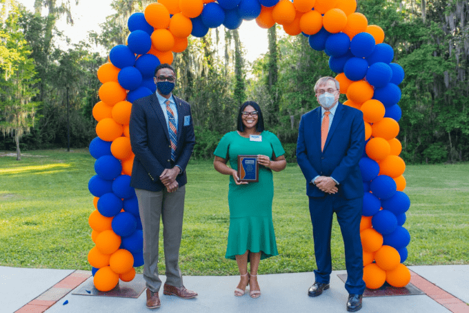 Danielle Butler receiving the community advocate award at the presidential service awards event